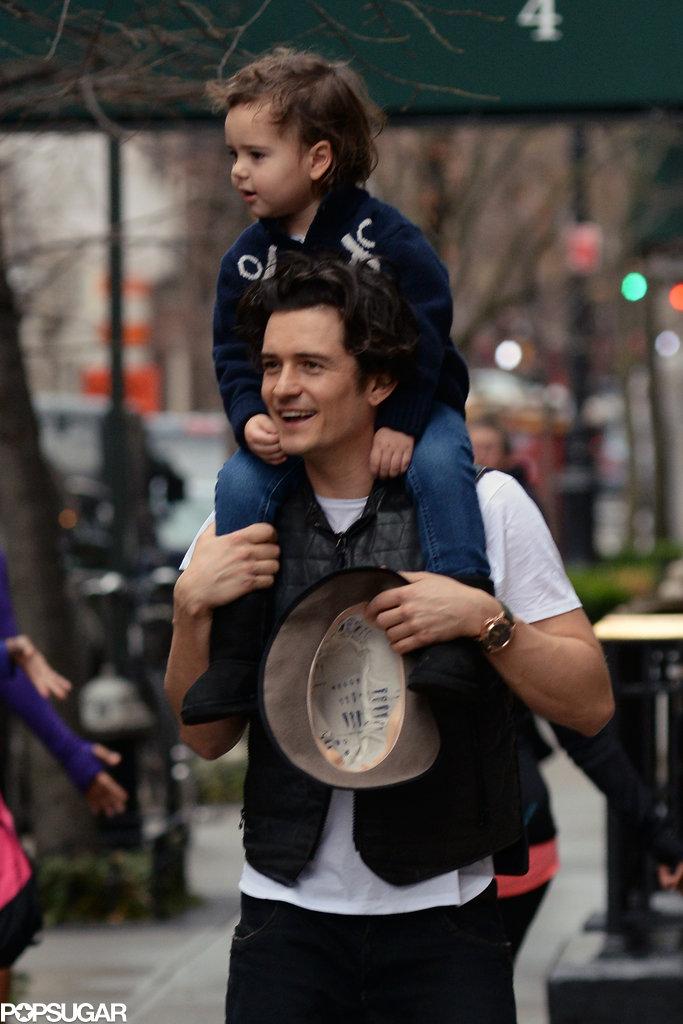Orlando Bloom gave his son, Flynn, a piggyback ride in NYC.