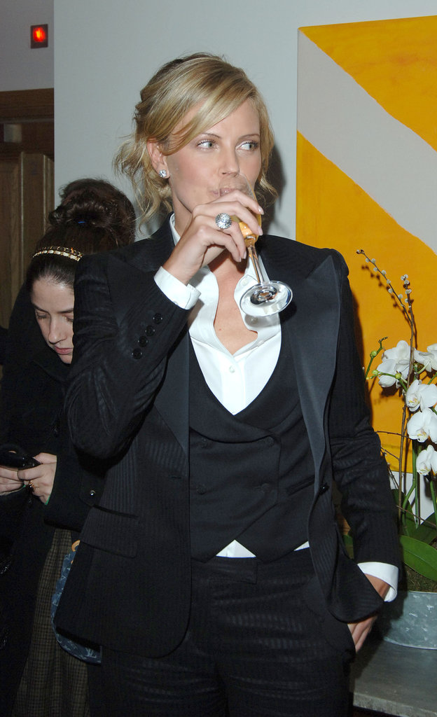 Charlize Theron sipped her Champagne in a sleek tuxedo look at the London screening of North Country in February 2006.