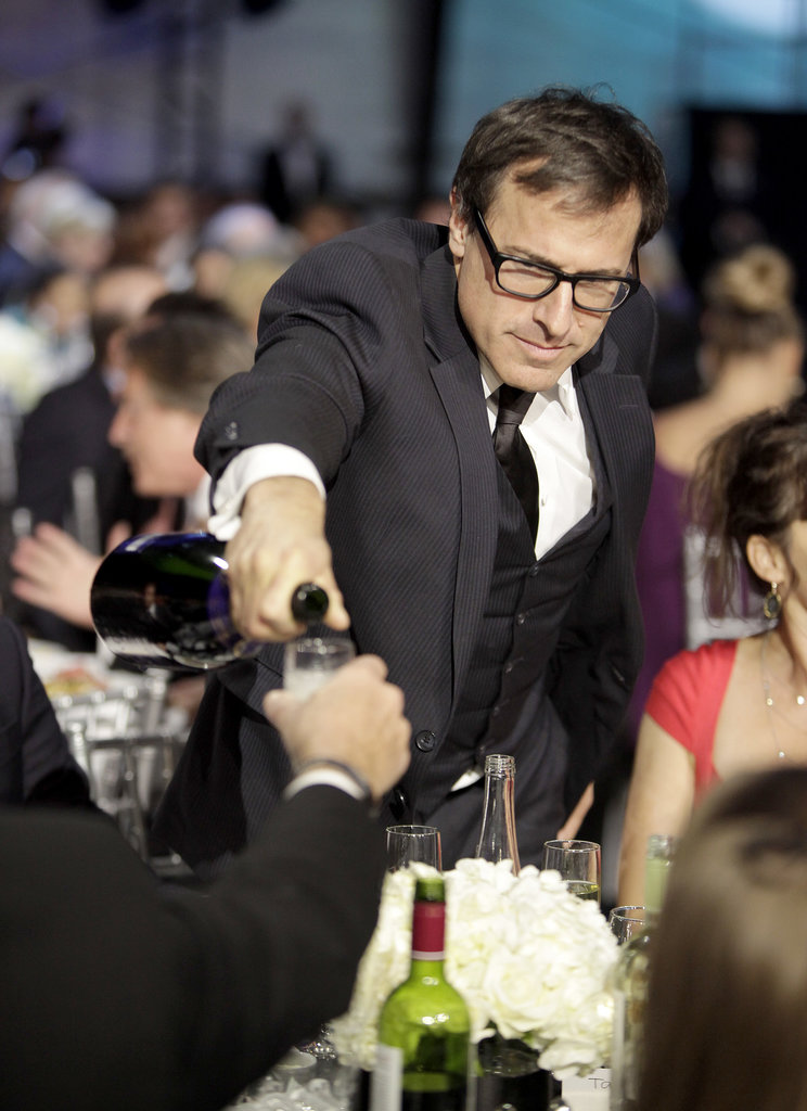 Director David O. Russell poured Champagne for his tablemates at the Critics' Choice Movie Awards in January 2013.