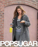 Gisele checked her phone during her daytime outing.