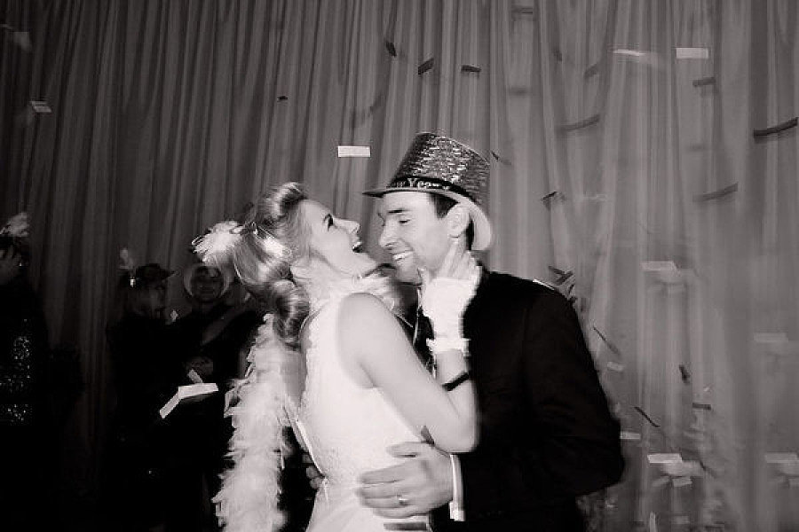 Have fun New Year's Eve top hats and boas for the photo booth that can be worn during the countdown as well. Photo by Kristin Vining via Style Me Pretty