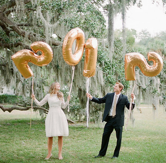 Use mylar number balloons to announce the new year!  Photo by Jessica Lorren via 100 Layer Cake