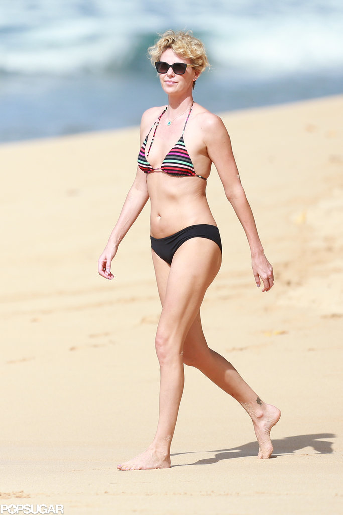 Charlize Theron showed off her enviable bikini body when she hit the beach in Hawaii on Monday.