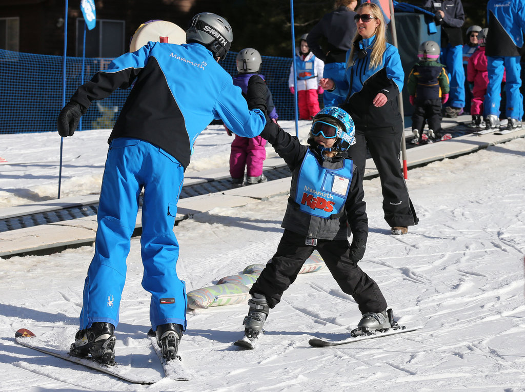 Zuma got a fist bump from his ski instructor.