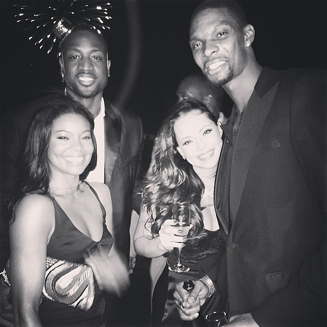 "Dwyane Wade reflected on his 2013 in the caption for his New Year's Eve photo with fiancée Gabrielle Union and friends, saying, ""2013 was filled with ups and downs,"" without which a person can't grow. Source: Instagram user dwyanewade"