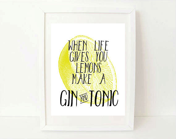 "Be inspired to make the best of things with this print ($12-$15) that reads: ""When life gives you lemons, make a gin and tonic."""