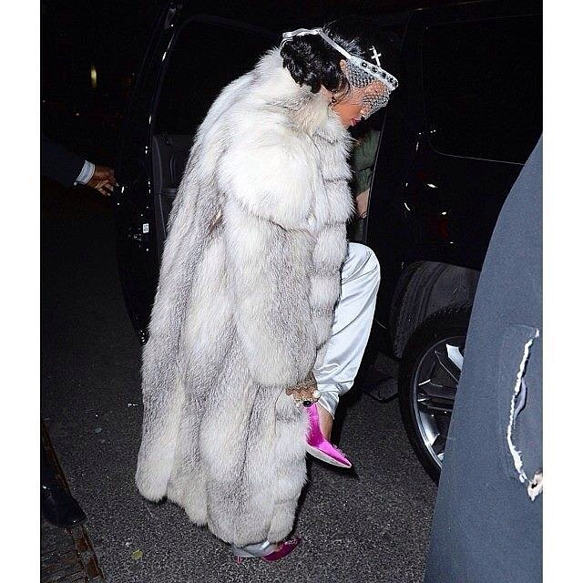 The singer topped her suit off with a gigantic white fur coat, a white veil, and pink shoes. Source: Instagram user badgalriri