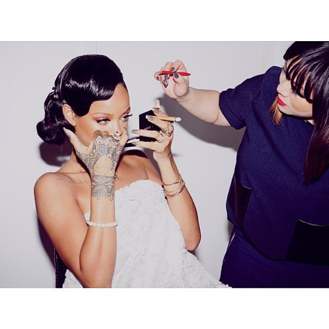 Rihanna started the night out by getting glam. We spy some Bobbi Brown powder in her hand! Source: Instagram user badgalriri