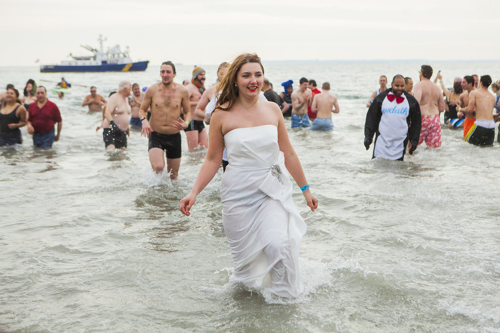 People kicked off 2014 with a chilly dip at Coney Island in NYC.