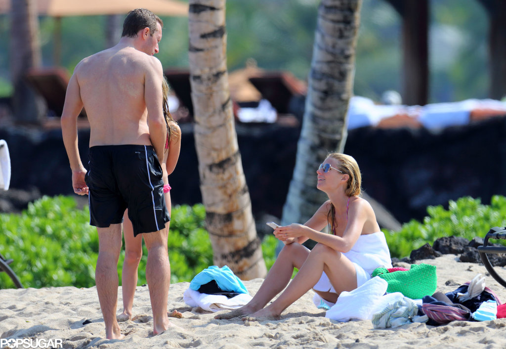 Gwyneth and Chris talked on the beach.