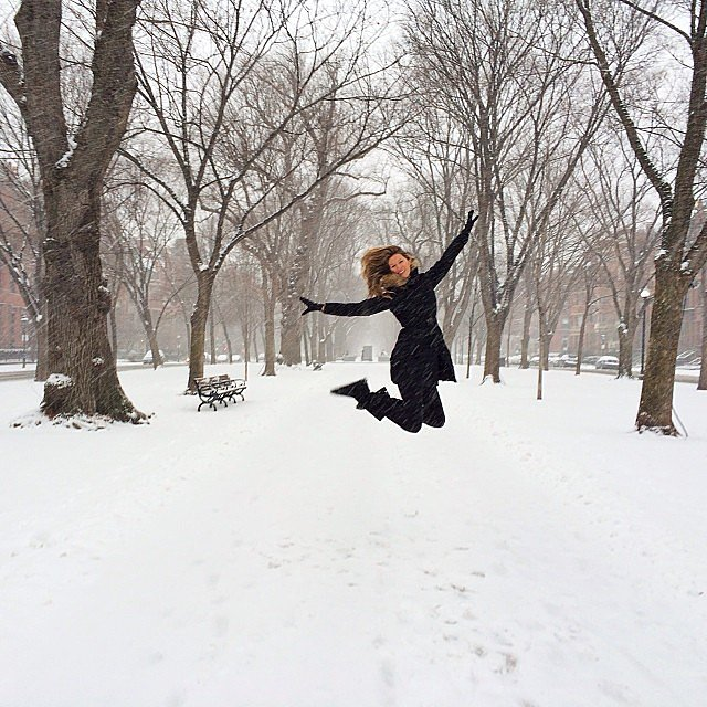 Gisele Bündchen jumped for joy during a snowy day in Boston. Source: Instagram user giseleofficial