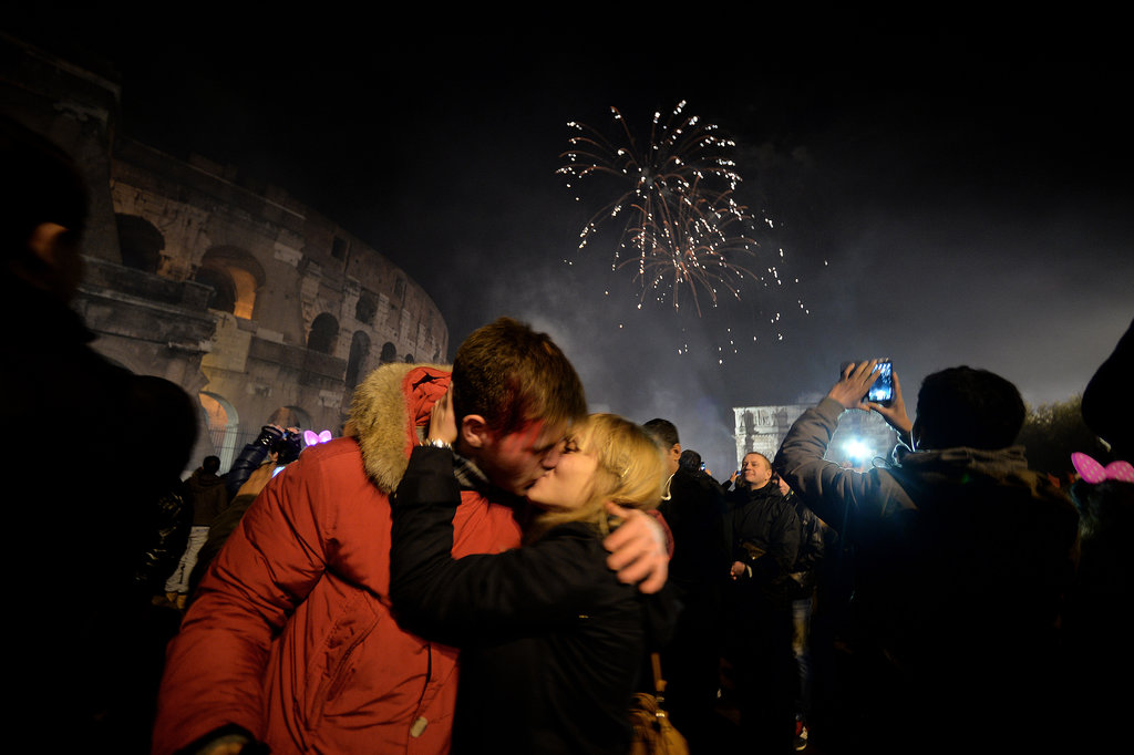 A couple kissed outside of the Colosseum in Rome, Italy.