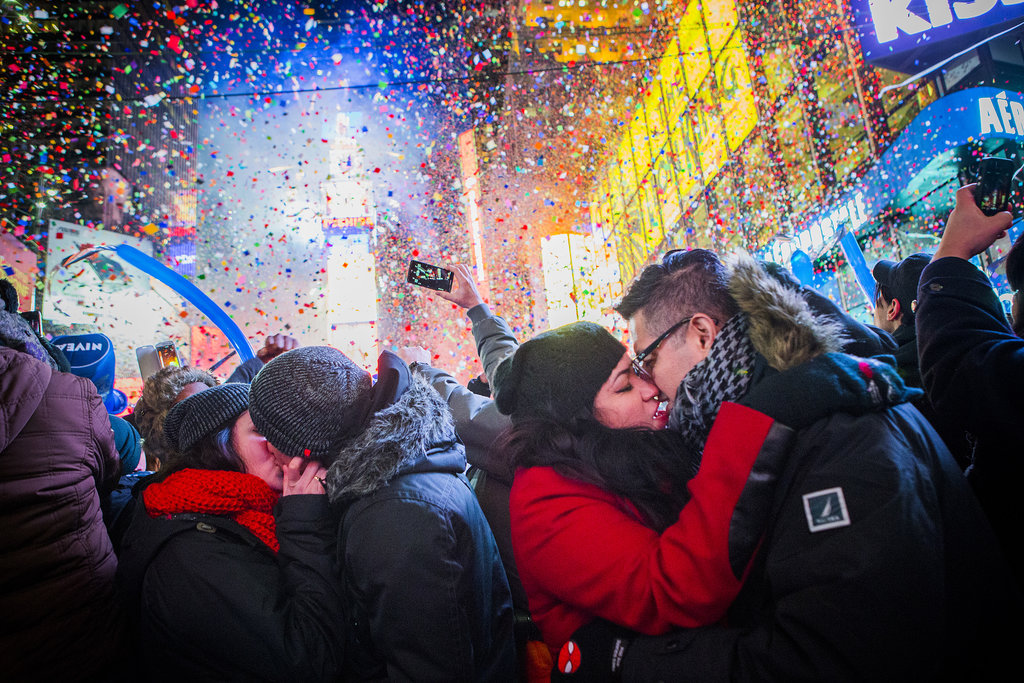 It was a streetside smooch for these pairs in New York City's Times Square.