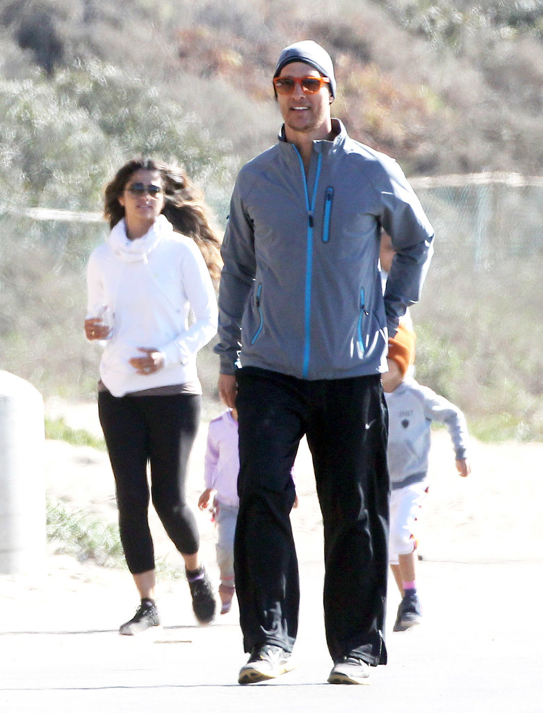 Matthew and Camila smiled as they jogged.