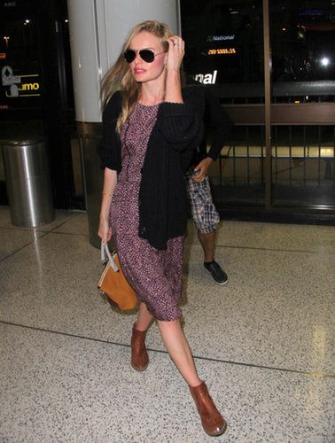 After her Montana wedding, Kate Bosworth kept the prairie vibe going when she flew home to California. She finished off a loose printed dress with leather boots and a black jacket.