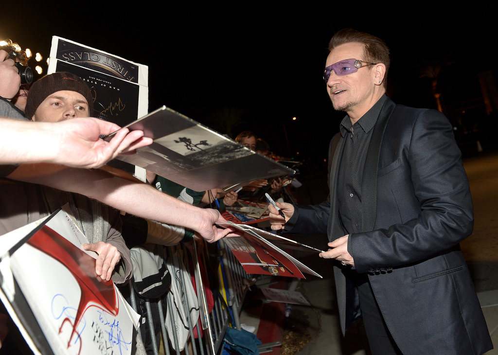 Bono wore his signature shades.
