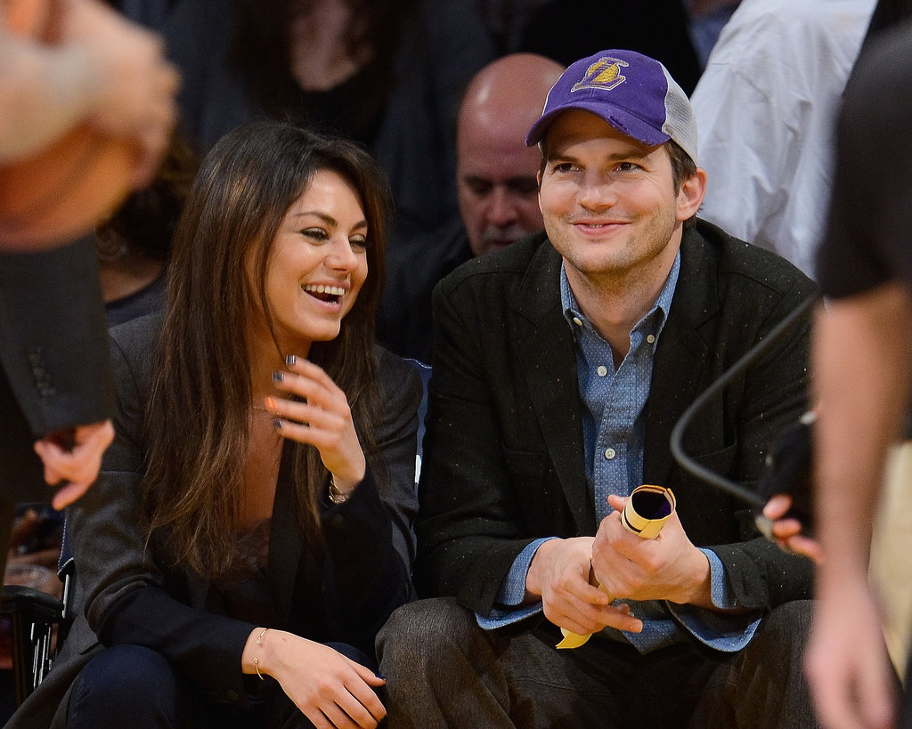Mila and Ashton smiled throughout the game.