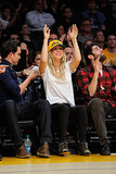 Kaley Cuoco threw her arms up for the Lakers.