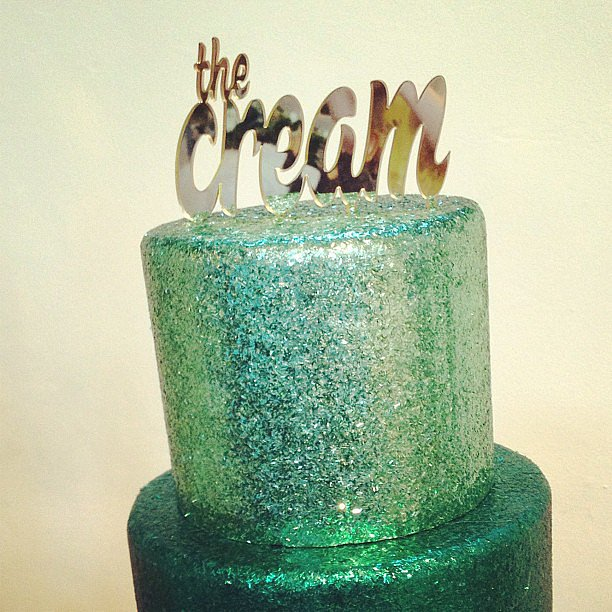 Metallic cake topper at The Cream.