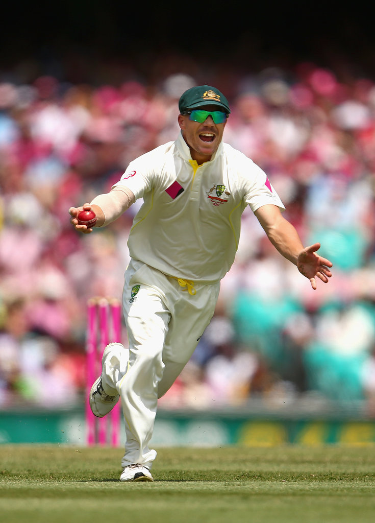 David Warner celebrated after taking a catch to dismiss Ian Bell of England off the bowling of Ryan Harris of Australia during day three.