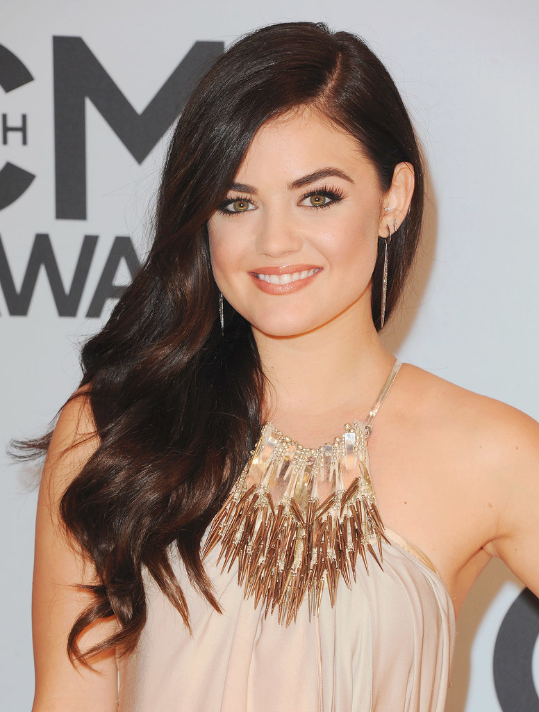 Sleek and sophisticated was the goal for Lucy at the 2013 CMA Awards, and she achieved it with a neutral makeup palette and soft curls thrown over the shoulder.