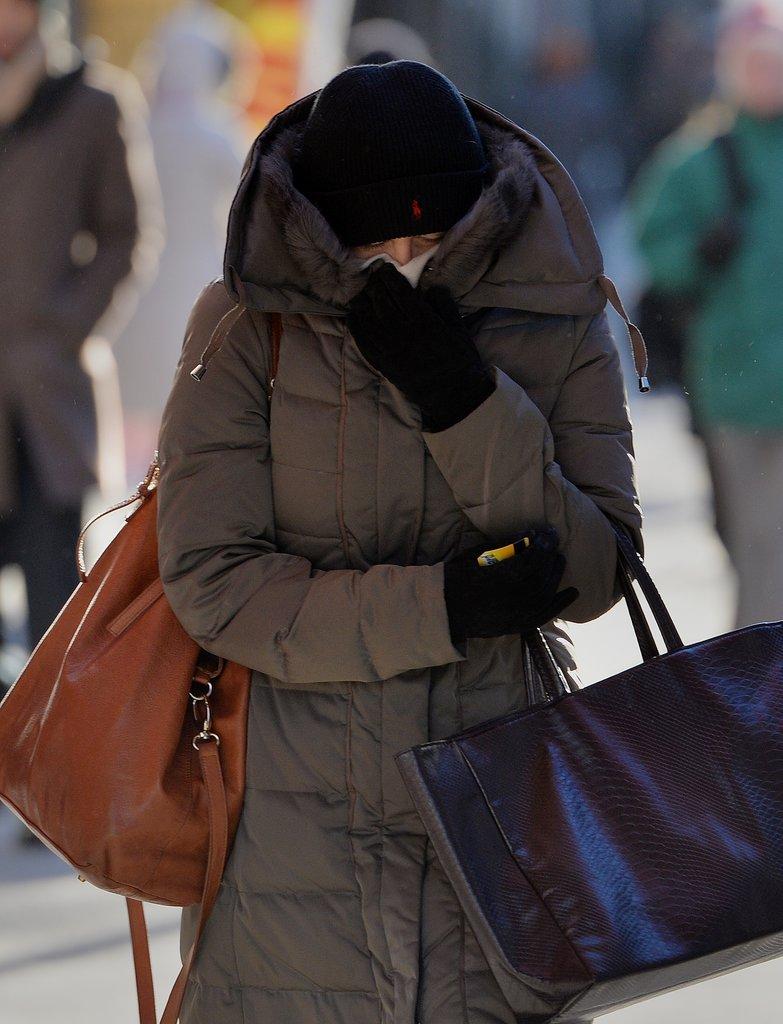 A very bundled-up woman made her way through Manhattan.