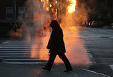A lone pedestrian hit the streets in NYC, where temperatures hit a record low of 4 degrees.