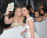 Reign's Adelaide Kane gave a sweet smile for a fan selfie.