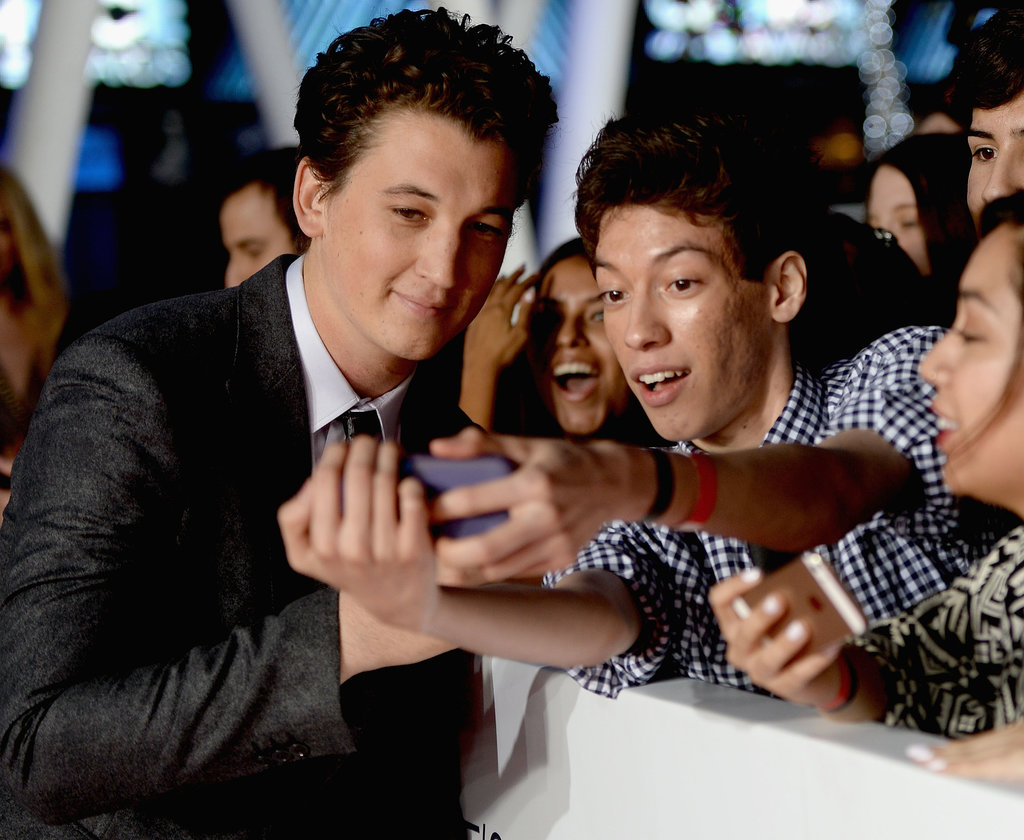 Miles Teller leaned in for a photo while walking the red carpet.