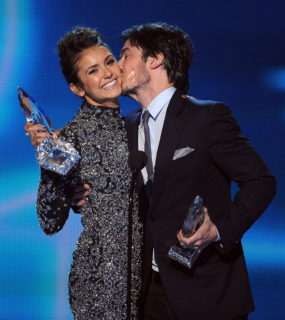Ian planted a big one on Nina's cheek.