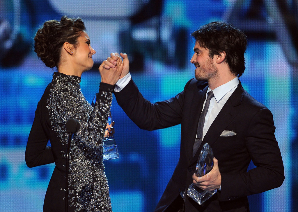 Ian and Nina clasped hands on stage.