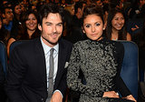 Ian and Nina sat together in the crowd.