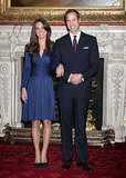Middleton glowed in a navy ruched Issa dress while posing with her handsome fiancé, now husband, William in November 2010.