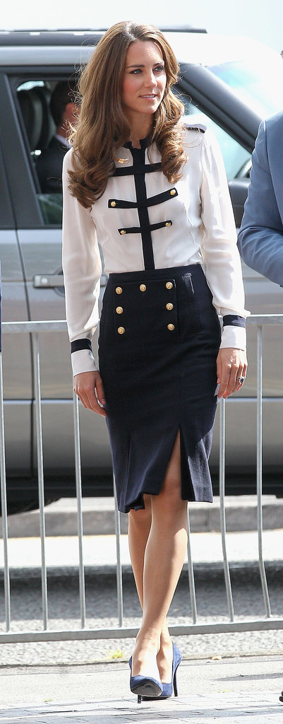 Even Kate's daywear is polished to perfection. The brunette stunner donned a military-inspired McQueen duo — contrast-trim blouse, and gold-buttoned pencil skirt — in Birmingham, England, in August 2011.