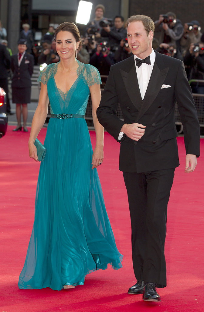 Middleton left us breathless in a teal Jenny Packham gown, featuring a plunging neckline, lace insets, and a jeweled belt, while walking the BOA Olympic Concert red carpet with Prince William in May 2012.
