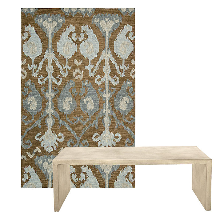 This ikat area rug ($220–$1,100) has mocha and aqua shades that are sophisticated yet relaxed. It pairs perfectly with the cream tones found in this concrete coffee table ($2,495).