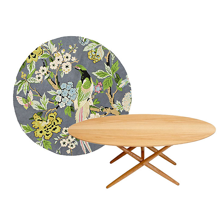 Modern meets whimsical for this pair. A floral round rug ($78–$598) makes an eclectic statement and brings softness to this oak coffee table ($2,595).