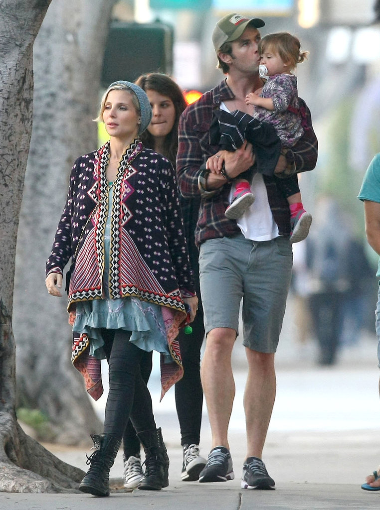 Chris kissed India while walking with Elsa.