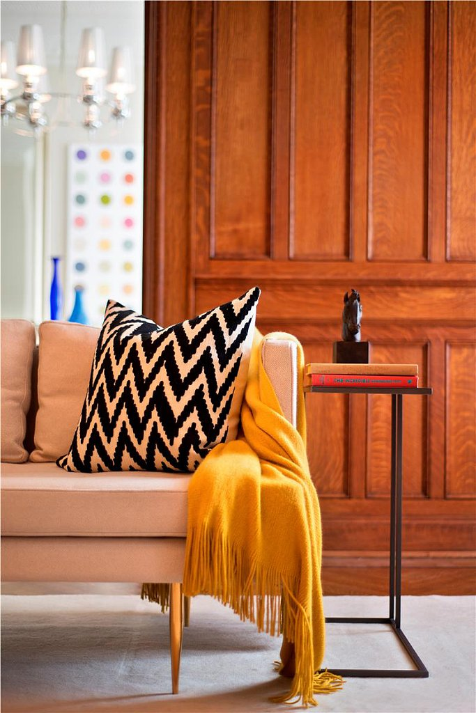 A chevron pillow and canary yellow throw are all the accessories this sofa needs. Source: Douglas Elliman Real Estate