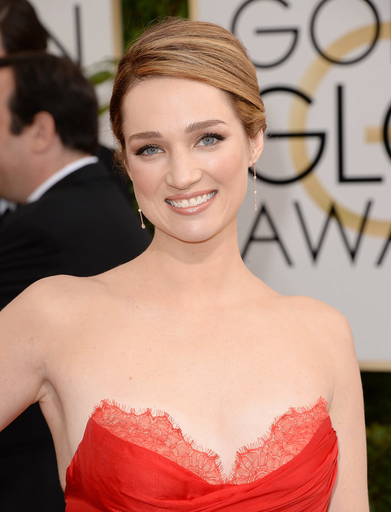 A little skin is always a win. Kristen Connolly's slick updo and fresh-faced makeup put her décolletage on full display.