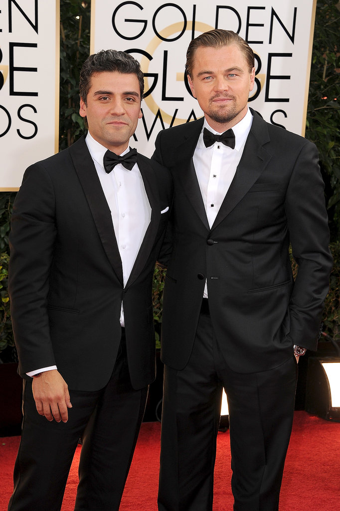 Oscar Isaac and Leonardo DiCaprio may be going against each other in the best actor category, but they looked friendly on the carpet.