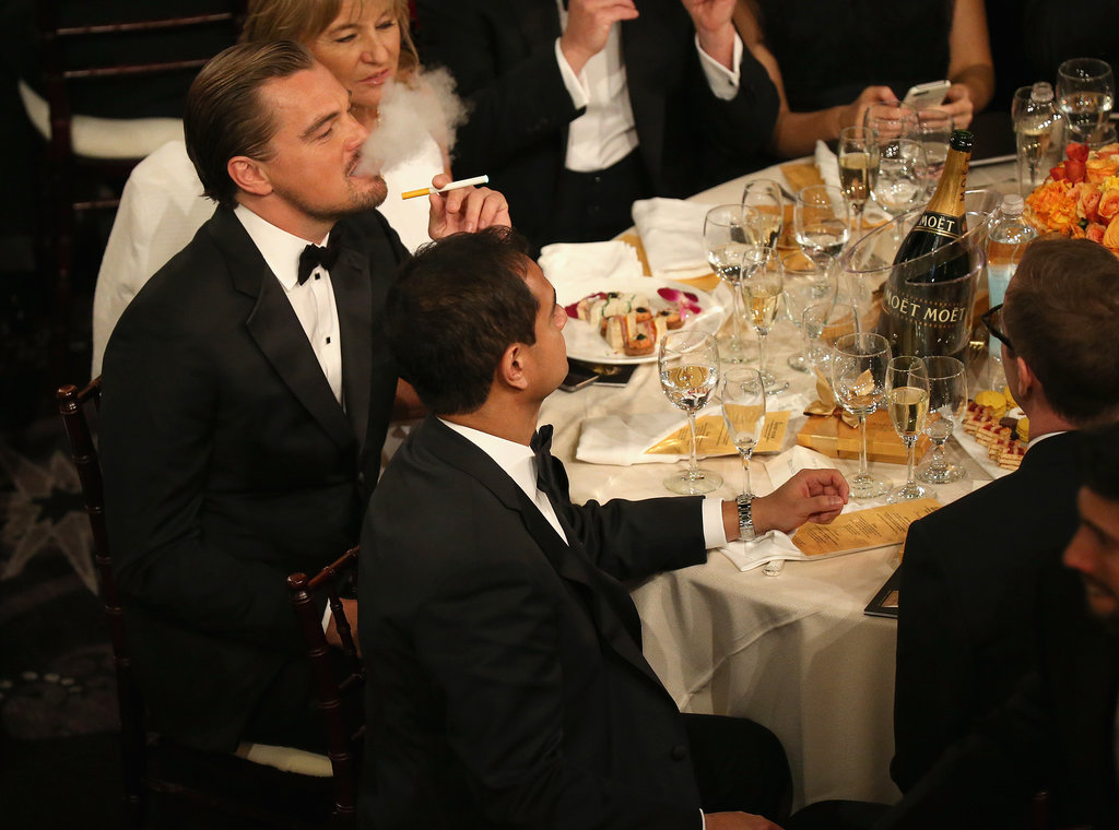 Leonardo DiCaprio lit up an electronic cigarette at his table.  Source: Christopher Polk/NBC/NBCU Photo Bank/NBC
