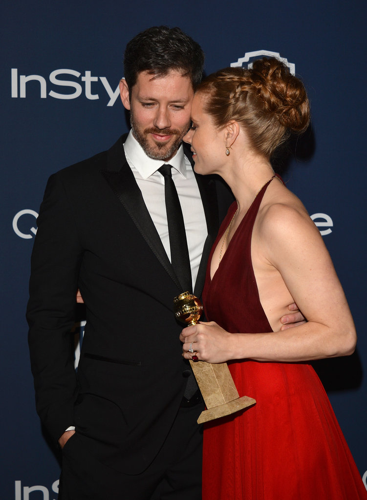 Amy Adams shared a sweet moment with Darren Le Gallo as she clutched her shiny new Golden Globe at the party.