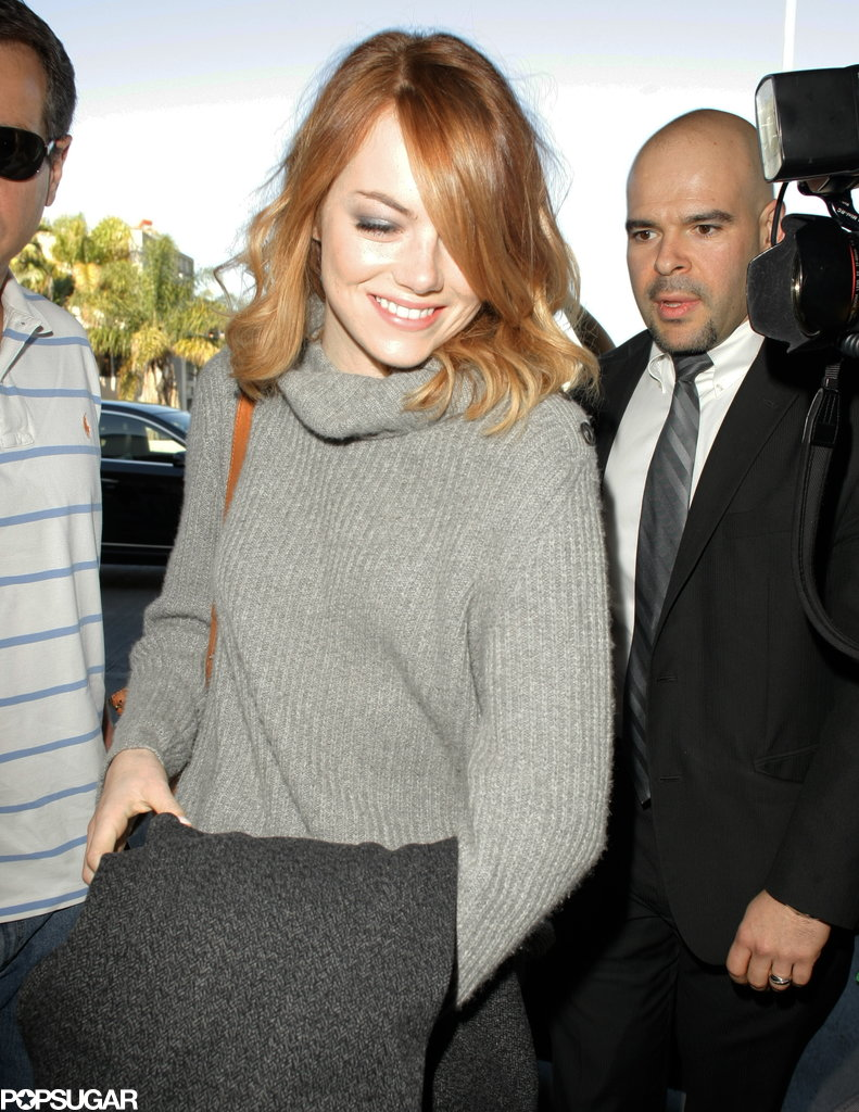 Emma Stone Takes a Selfie Break at the Airport