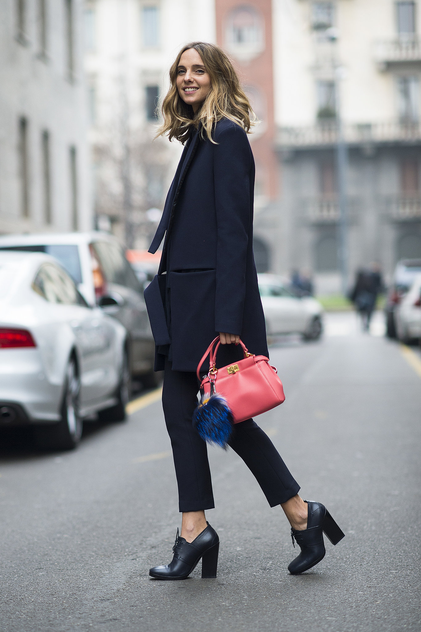A bright bag and furry Fendi charm gave this menswear-inspired look a girl's touch.  Source: Le 21ème | Adam Katz Sinding