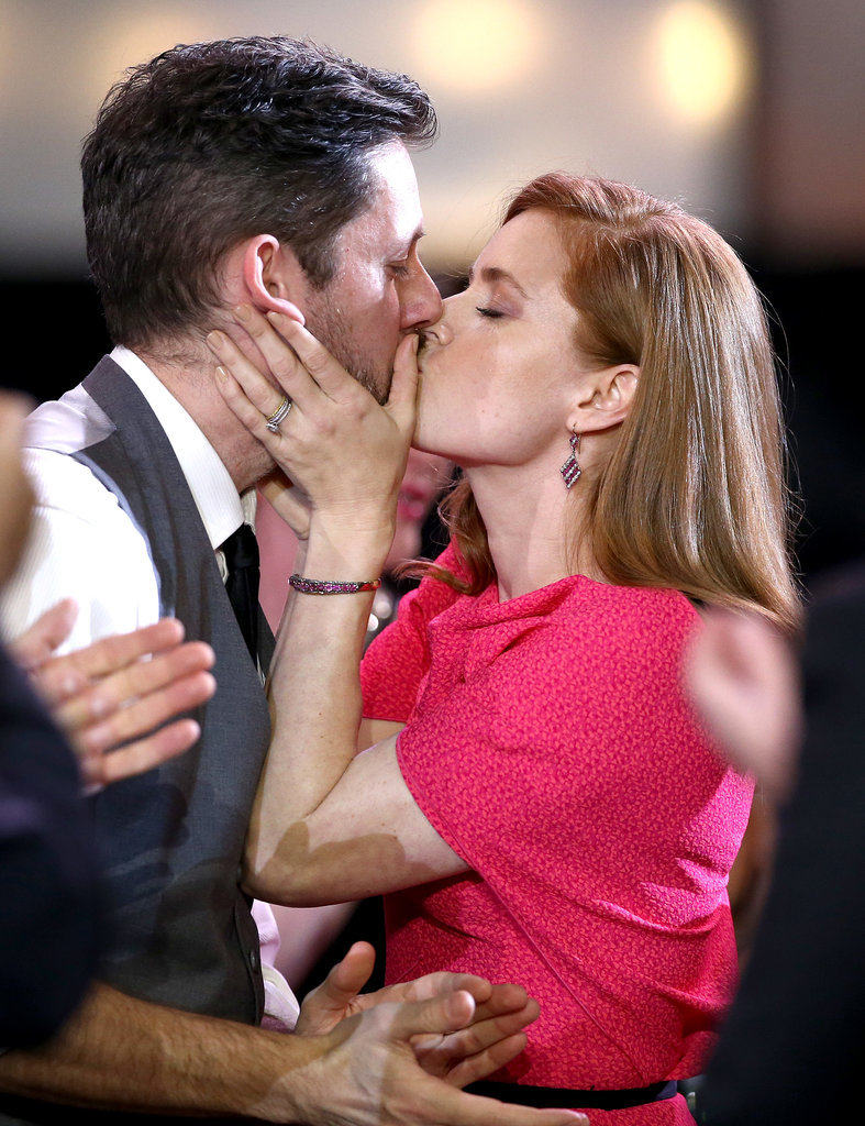 Amy Adams kissed her husband before heading up to the stage to accept her award.