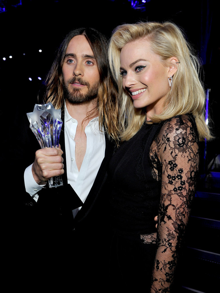 Margot Robbie was Jared Leto's arm candy as he posed with his award.