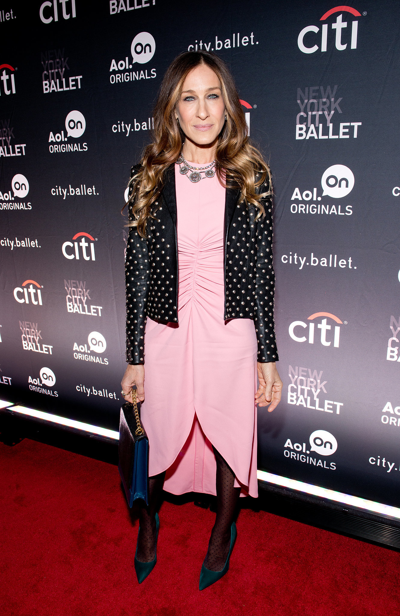 Leave it to Carrie Bradshaw Sarah Jessica Parker to absolutely kill it in a sheer-sleeved pastel pink Giles high-low dress and studded Saint Laurent jacket in November 2013. We won't even get into those luxe forest-green pumps a