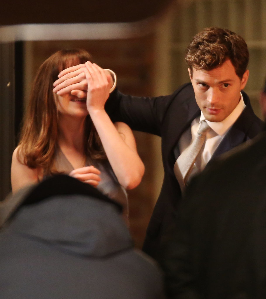 Dakota Johnson and Jamie Dornan gave us a glimpse of their chemistry on the set of Fifty Shades of Grey in Vancouver on Thursday while filming a  scene in which Christian gives Anastasia a new Audi.