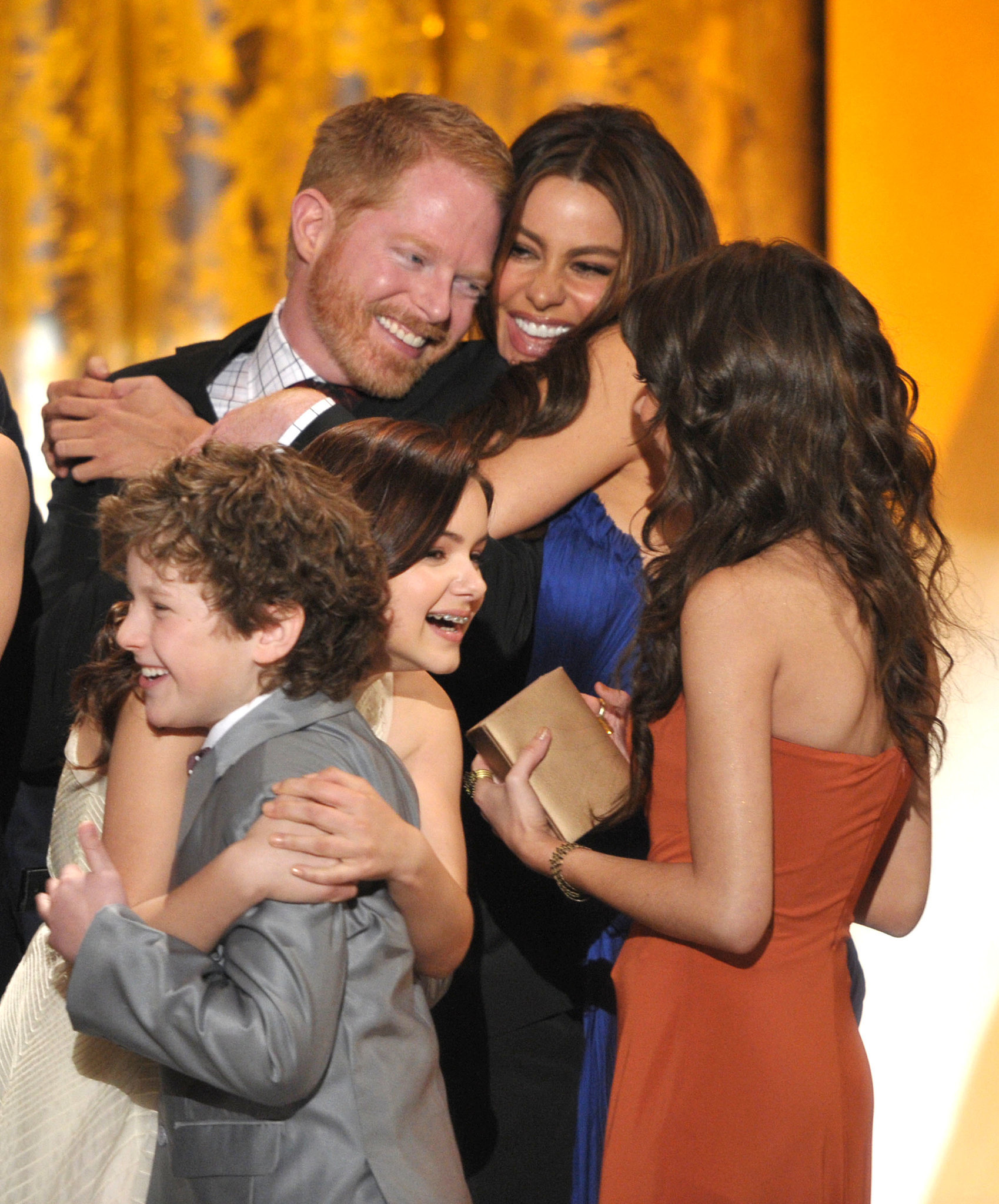 The cast of Modern Family celebrated their win for outstanding performance by an ensemble in a comedy series in 2011.